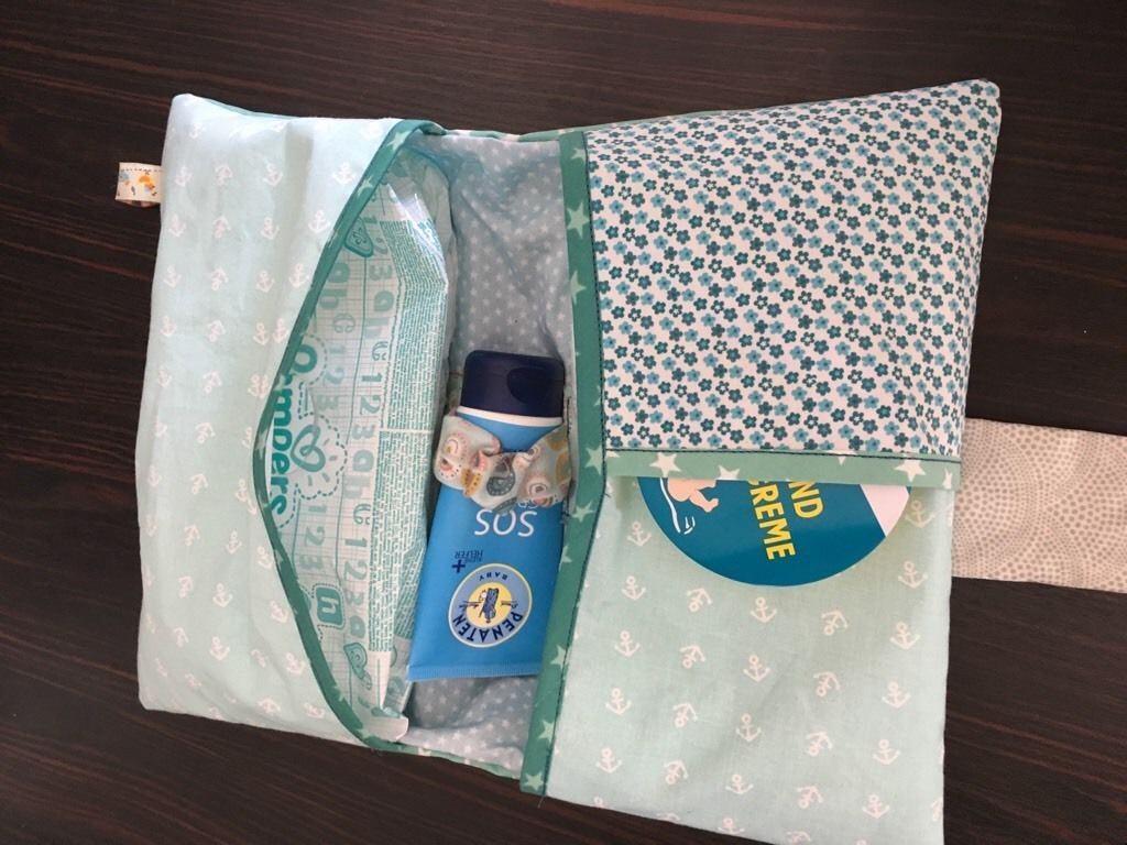 Kleinesbild - Handgemachte Wickeltasche