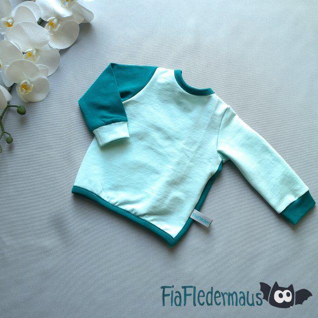 Kleinesbild - Selbstgenähtes Shirtjäckchen aus Jersey mit Pailettenstern in Größe 62 kaufen