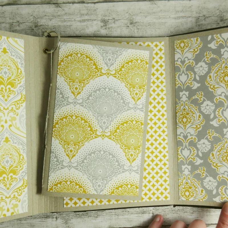 Kleinesbild - Handgemachtes Upcycling-Buch aus einem älteren Clutch in Gelb, Grau und Weiß Din A5