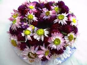 Kleinesbild - Naturkranz mit Amaranth Blumen und Sonnenflügeln