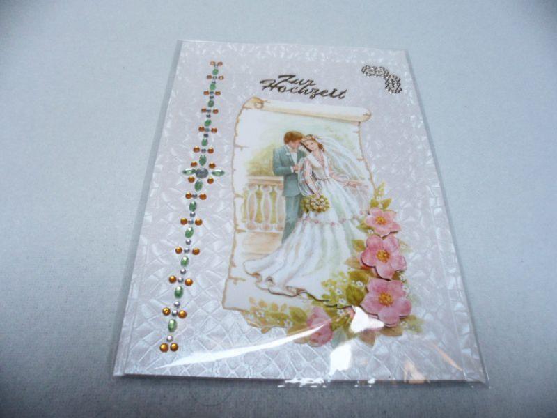 Kleinesbild - Eine anspruchsvolle 3D Karte zur Hochzeit. Ein Brautpaar dekoriert mit Blumen in 3D. Acrylsteinchen und Sticker. Bis 6 Karten Portogebühren 1,45€