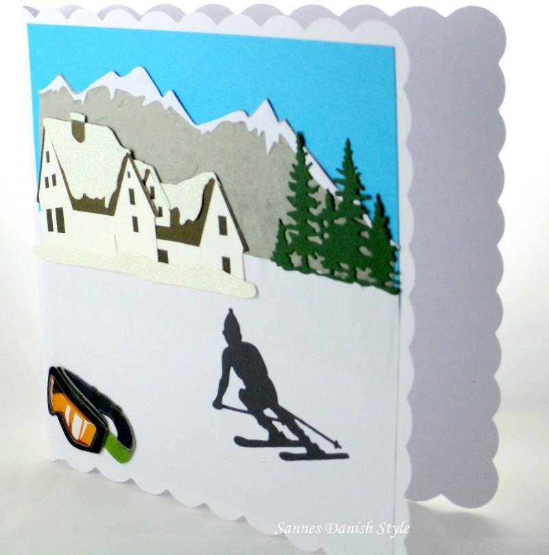 Kleinesbild - Grußkarte, Geburtstagskarte, Glückwunschkarte für Skiurlauber, mit Hotel, Skibrille und Skiläufer, die Karte ist ca. 15 x 15 cm