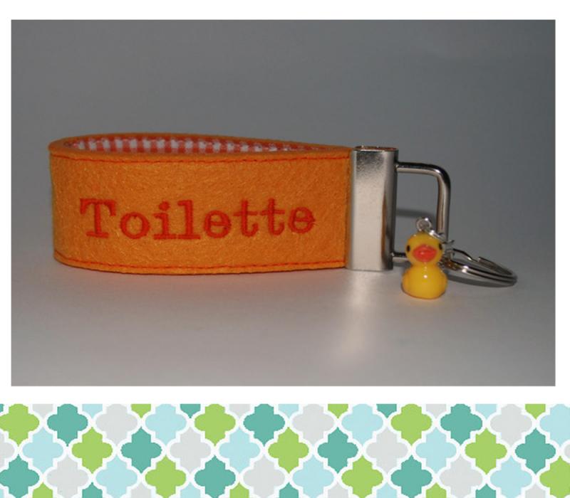 - Schlüsselanhänger  Toilette - Schlüsselanhänger  Toilette