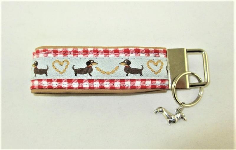 Kleinesbild - Schlüsselanhänger/Schlüsselband Würstchenklau Anhänger Band für Schlüssel mit lustigen Dackeln Schlüsselband für Hundefreunde für Tierfreunde für Frauen unterlegt mit Kunstleder