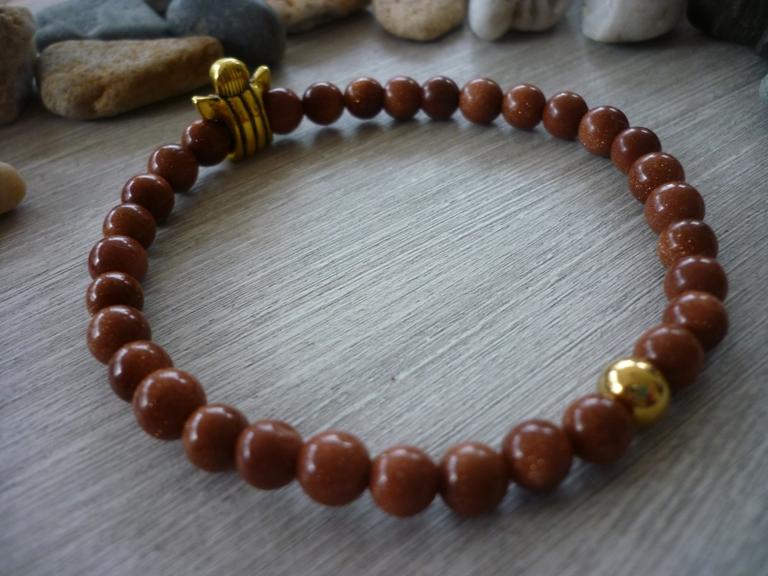 Kleinesbild - Handgemachtes Armband aus Goldflussperlen mit einem Schutzengel