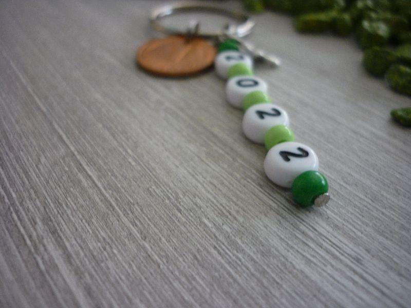 Kleinesbild - Schlüsselanhänger 2022 mit Kleeblatt und Glückspfennig