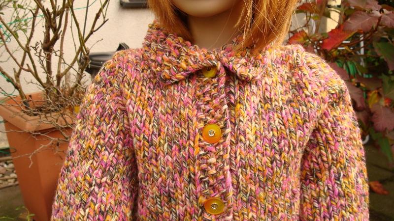 Kleinesbild - gestrickte warme Grob-Longstrickjacke aus  einem Melange-Garn in der Farbe orange/braun/rosa in Gr. 110