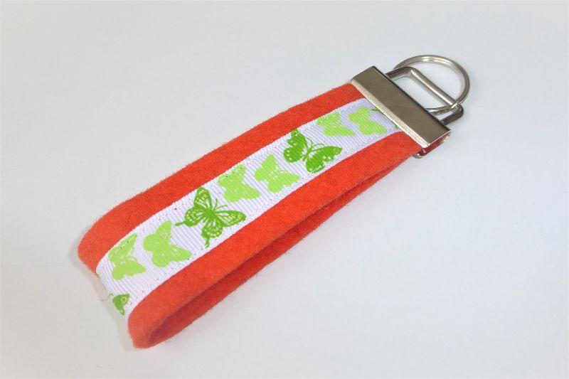 - 1 Schlüsselband aus Wollfilz mit Ripsband grüne Schmetterlinge, orange - 1 Schlüsselband aus Wollfilz mit Ripsband grüne Schmetterlinge, orange