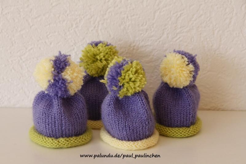 Kleinesbild - Eierwärmer, Eiermützen mit Bommel, lila/gelb, gestrickt   bei Paul & Paulinchen