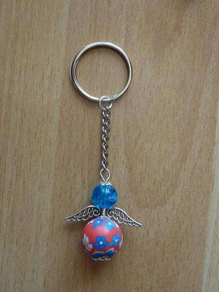Kleinesbild - Handgefertigter Schlüsselanhänger mit Metallflügeln - türkis-rot