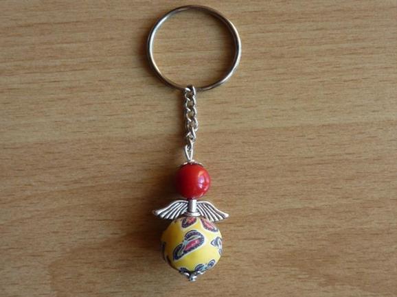 Kleinesbild - Handgefertigter Schlüsselanhänger mit Metallflügeln - rot-gelb