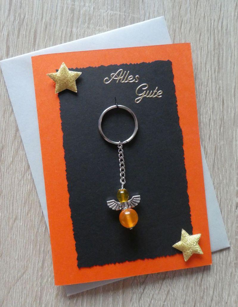 - Schlüsselanhänger Engel inkl. Grußkarte und Briefumschlag (orange, schwarz, grau) - Schlüsselanhänger Engel inkl. Grußkarte und Briefumschlag (orange, schwarz, grau)