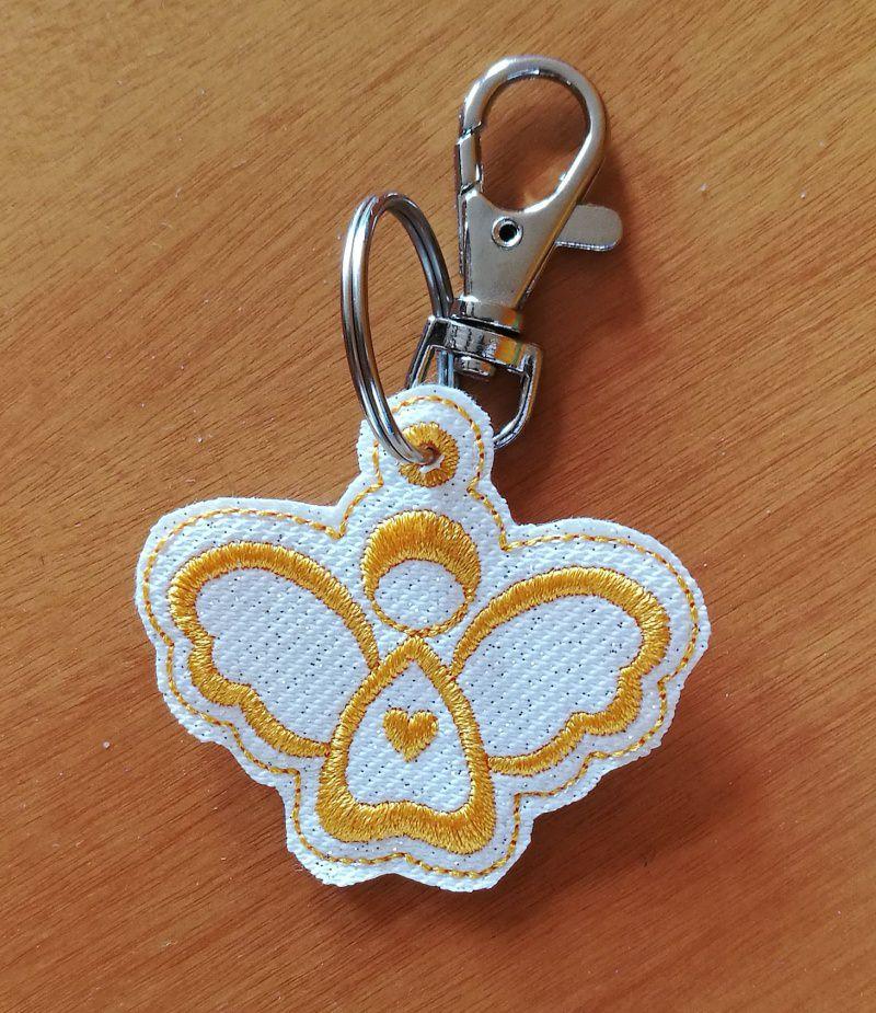 - Schlüsselanhänger aus Kunstleder mit Engelmotiv - Schlüsselanhänger aus Kunstleder mit Engelmotiv