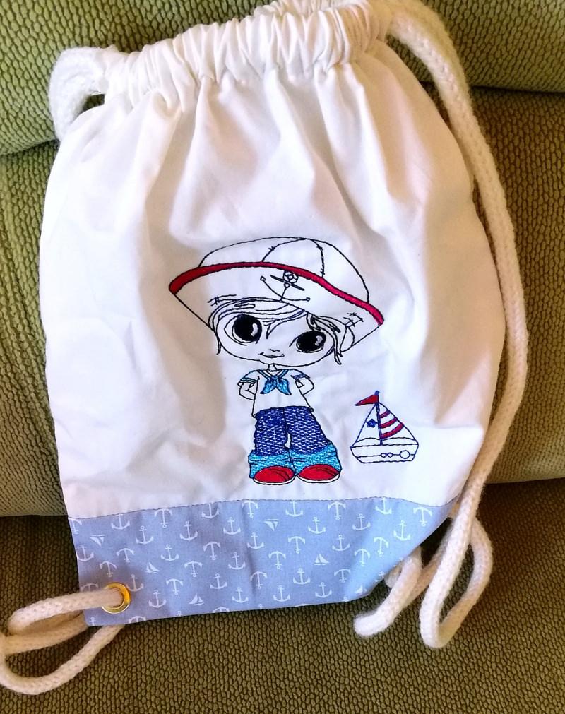 Kleinesbild - kleiner dekorativer Kinderturnbeutel aus Baumwolle mit Seemann