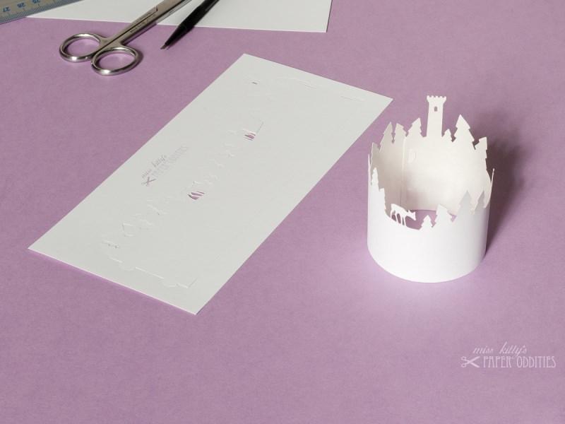 Kleinesbild - Windlicht-Bastelbogen »Winterwald« zum Beleuchten mit einem (LED)-Teelicht