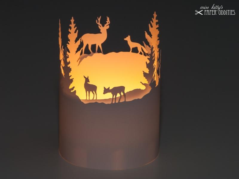 Kleinesbild - Windlicht-Bastelbogen »Tiere im Winterwald« – weiß; zum Beleuchten mit einem (LED)-Teelicht