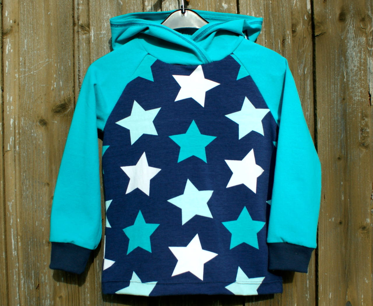 Kleinesbild - Kapuzenshirt MEGASTARS für Jungen und Mädchen Gr. 122/128 Hoodie Kapuze Sterne blau türkis Jersey Baumwolle cool lässig