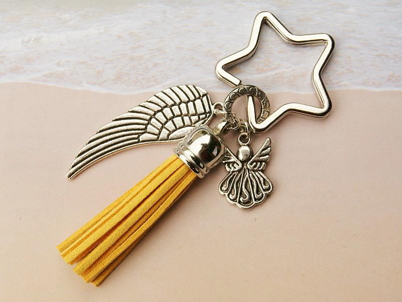 Kleinesbild - Schlüsselanhänger Taschenanhänger Glücksbringer Engel Flügel Quaste gelb