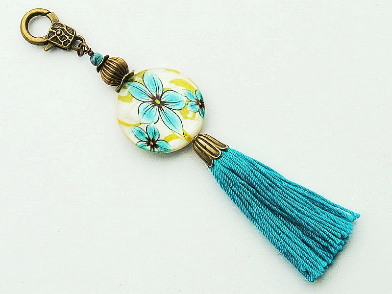 Kleinesbild - Schlüsselanhänger Taschenanhänger Perlmutt mit Blumen Quaste türkis Kettenanhänger bronzefarben