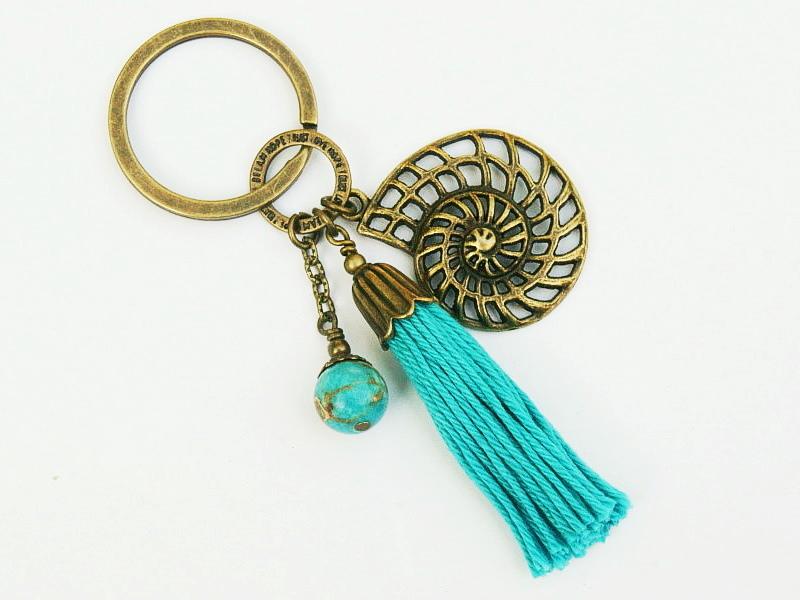 Kleinesbild - Schlüsselanhänger Glücksbringer Quaste türkis Schnecke Spirale Jaspis Edelstein bronzefarben