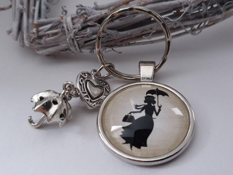 Kleinesbild - Kindermädchen Mary P. Schlüsselanhänger Glascabochon handgefertigt Regenschirm Herz Märchenfigur Geschenk für Erzieherinnen Frauen zum Dankesagen