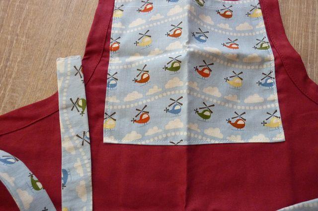Kleinesbild - Kinderschürze genäht aus Baumwollstoffen, mit Hubschraubern kaufen~ Backschürze ~ Kochschürze ~ Kaufladenschürze
