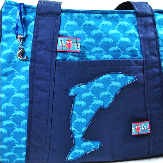 Kleinesbild - Schicke, kleine Mädchenhandtasche mit Delphin,türkis-blau
