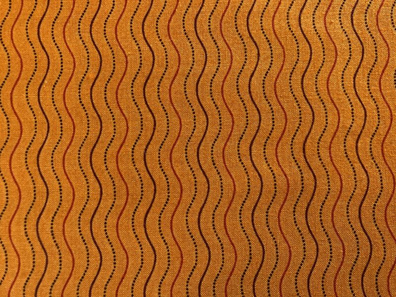- Baumwollstoff, orange mit Wellenlinien - Baumwollstoff, orange mit Wellenlinien