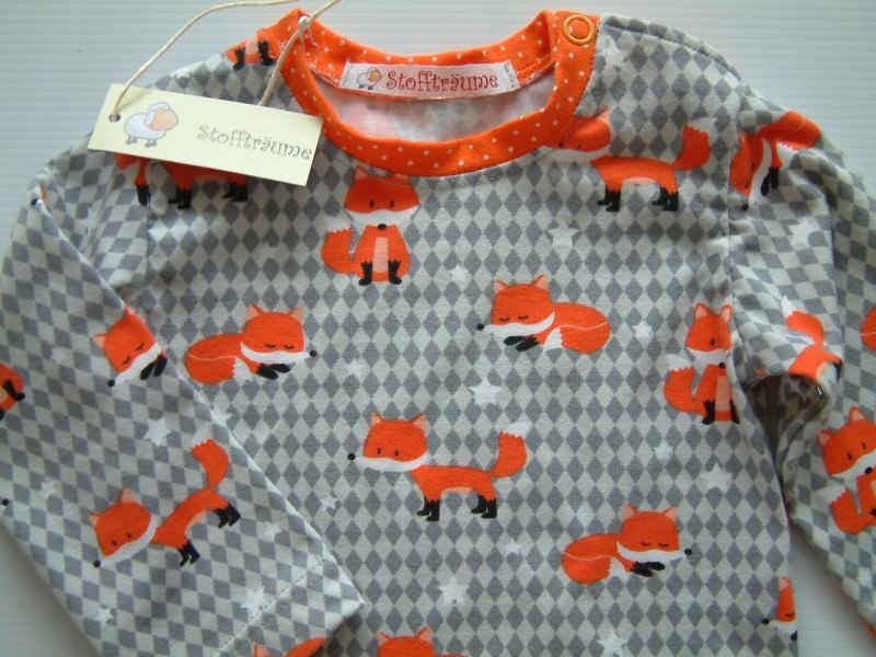 Kleinesbild - Ein ganz besonderer Babybody aus Jersey mit wunderbaren Fuchsmotiven, Babyunterwäsche