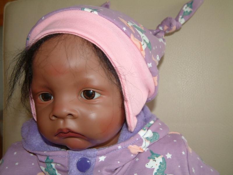 Kleinesbild - Baby-jerseymütze mit Einhornmotivstoff genäht und Innen abgefüttert