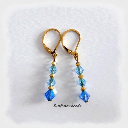Kleinesbild - Ohrringe mit Glasschliffperlen blau gold und Edelstahlbrisuren gold