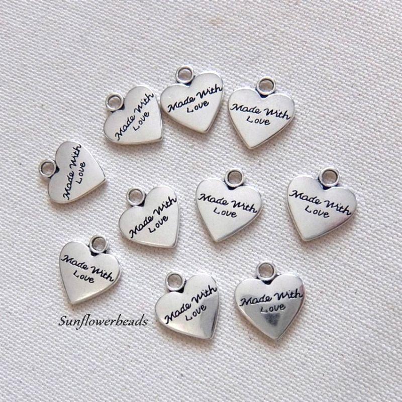 Kleinesbild - 10 Metallanhänger Herz silber, mit Aufschrift made with love