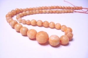 Jade Apricot 14-6 mm facettiert, Verlauf  Strang