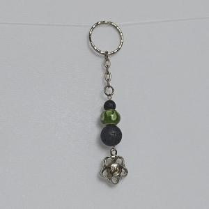 Schlüsselanhänger Taschenbaumler -zum Beduften- schw. Lavaperlen, Glas-Modulperle und Anhänger ''Blume/Smiley''