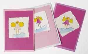 Farbige Karte mit handgemaltem Engel auf Aquarellpapier