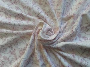 Bi-elastischer Jersey zart gemustert auf cremefarbigem Grund 160 cm breit