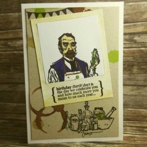 Handgemachte Klappkarte Chemistry Birthday mit Polaroidrahmen und Klecksen in Grün und Lila Din A6