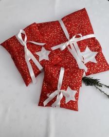 Geschenkverpackung aus weihnachtlichem Stoff in Rot - Handarbeit kaufen