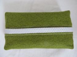 Tatüta grün mit schwarzen Spiralen und silbernem Innenfutter