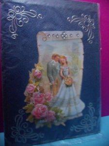 Eine anspruchsvolle 3D Karte zur Hochzeit. Ein Brautpaar dekoriert mit Rosen in 3D. Acrylsteinchen und Sticker