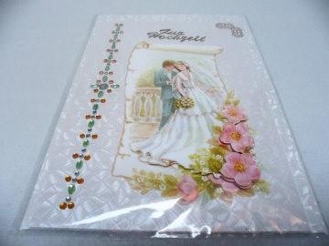Eine anspruchsvolle 3D Karte zur Hochzeit. Ein Brautpaar dekoriert mit Blumen in 3D. Acrylsteinchen und Sticker