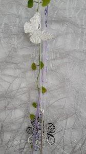 Dekorative Kette mit  Glastropfen, Schleifen und Kunstgrün