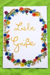Handgemalte Karte mit Blumenkranz und