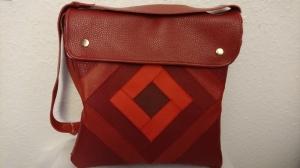 Ledertasche im Patchwork Style in verschiedenen Rottönen - Handarbeit kaufen