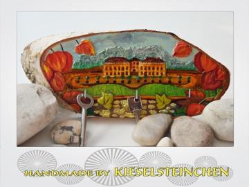 Schlüsselbrett als Baumscheibe mit Schlossgarten