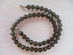 Halskette aus Rauchquarz mit einem Karabinerverschluss aus Silber - Handarbeit kaufen