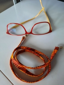 Braun-orange-gelb gemustertes Brillenband mit etwas gold