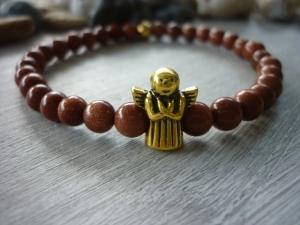 Handgemachtes Armband aus Goldflussperlen mit einem Schutzengel - Handarbeit kaufen