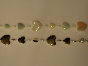 2 Herzchenbänder in gold und perlmutt