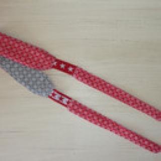 Sportstirnband mit seitlichem Gummizug in rot-grau von ideenReich kaufen
